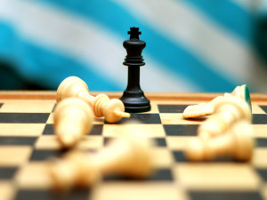 A Game of Critical Thinking and Social Skills: Chess