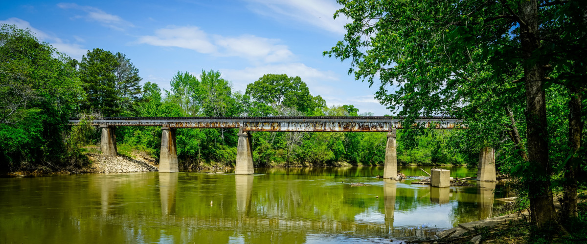 Landscape photograph of a train bridge crossing a lake